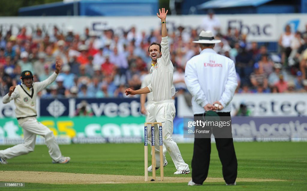 Australian fielder Usman Khawaja (l) and bowler Nathan Lyon appeal with success after Khawaja had caught England batsman Jonathan Trott during day one of 4th Investec Ashes Test match between England and Australia at Emirates Durham ICG on August 09, 2013 in Chester-le-Street, England.