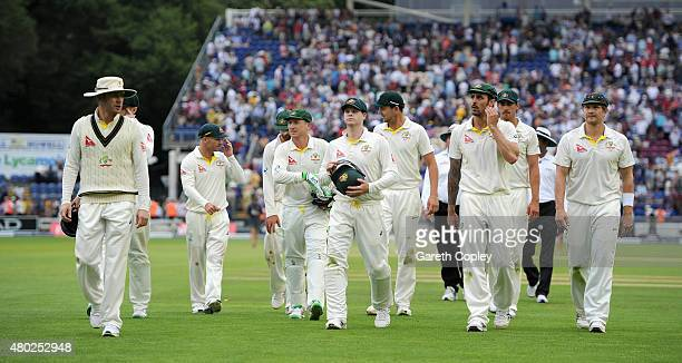 Australian fielders leave the field after day three of the 1st Investec Ashes Test match between England and Australia at SWALEC Stadium on July 10...