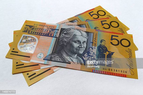 Australian fiftydollar banknotes are arranged for a photograph in Sydney Australia on Monday May 28 2012 The Australian dollar touched its highest...
