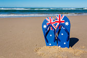Australian flag flip flop thongs on a beach