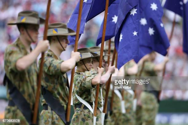 Australian flag bearers are seen during the Anzac Day ceremony before the round eight NRL match between the Sydney Roosters and the St George...