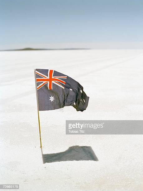 Australian flag planted into salt flat