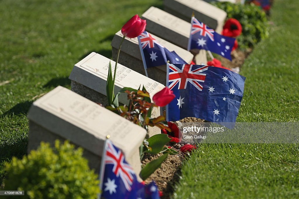 Australian flags likely left by visitors flutter among the gravestones of Australian soldiers killed during the Gallipoli Campaign at the Lone Pine...