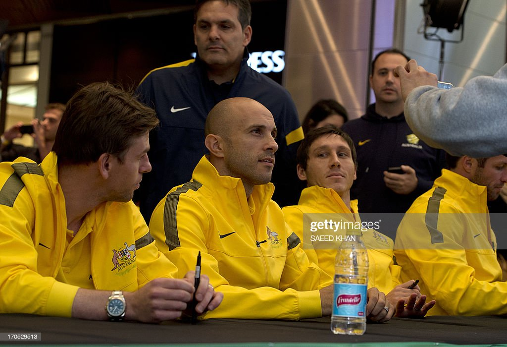 Australian football player Mark Bresciano (C) looks on during a Socceroos public appearance in Sydney on June 14, 2013. Australia will face Iraq in Sydney on June 18 with victory booking them a spot in the 2014 World Cup. AFP PHOTO / Saeed KHAN