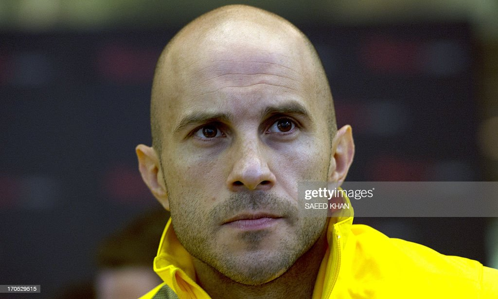 Australian football player Mark Bresciano looks on during a Socceroos public appearance in Sydney on June 14, 2013. Australia will face Iraq in Sydney on June 18 with victory booking them a spot in the 2014 World Cup. AFP PHOTO / Saeed KHAN