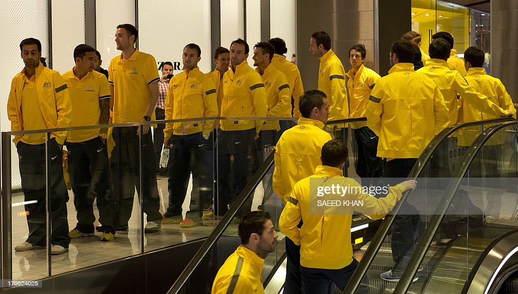 Australian football players attend a Socceroos public appearance in Sydney on June 14, 2013. Australia will face Iraq in Sydney on June 18 with victory booking them a spot in the 2014 World Cup. AFP PHOTO / Saeed KHAN