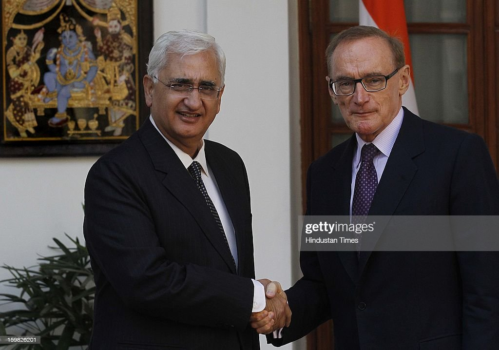 Australian Foreign Minister Bob Carr along with Salman Khurshid External affairs Minister (L) arrive for a photo opportunity before their meeting on January 21, 2013 in New Delhi, India.