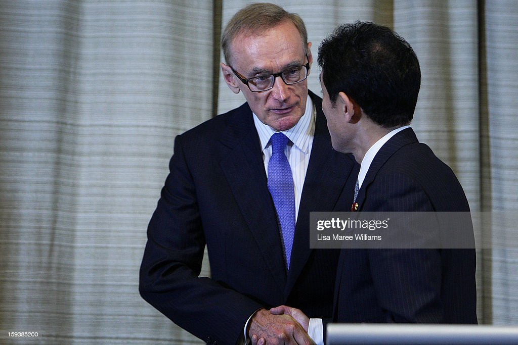 Australian Foreign Minister <a gi-track='captionPersonalityLinkClicked' href=/galleries/search?phrase=Bob+Carr&family=editorial&specificpeople=209391 ng-click='$event.stopPropagation()'>Bob Carr</a> shakes hands with Japanese Foreign Minister Fumio Kushida during a press conference during bilateral meetings at the Intercontinental Hotel on January 13, 2013 in Sydney, Australia. This is the first overseas assignment for Japanese Foreign Minister Fumio Kushida who will also meet with Australian Trade Minister Craig Emerson during his one day visit to the country.