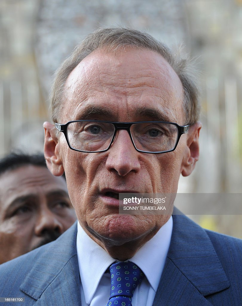Australian foreign minister Bob Carr speaks to journalists after laying a wreath at a monument for victims of 2002 Bali in Kuta on Bali island on April 1, 2013. Carr is on the resort island of Bali to attend the fifth Bali Regional Ministerial Conference on people smuggling, trafficking in Persons and telated transnational crime.