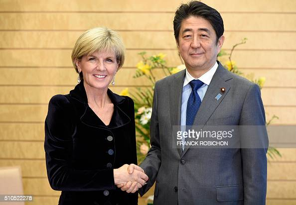Australian Foreign Minister Julie Bishop shakes hands with Japanese Prime Minister Shinzo Abe prior to their meeting at Abe's official residence in...