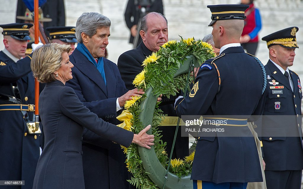 Australian Foreign Minister Julie Bishop(L), US Secretary of State John Kerry(2nd L), Australian Defence Minister David Johnston(3rd L), US Secretary of Defense Chuck Hagel(obscured)participate in a wreath laying ceremony at the Tomb of Unknown Soldier, November 20, 2013, at Arlington National Cemetery. AFP PHOTO / Paul J. Richards