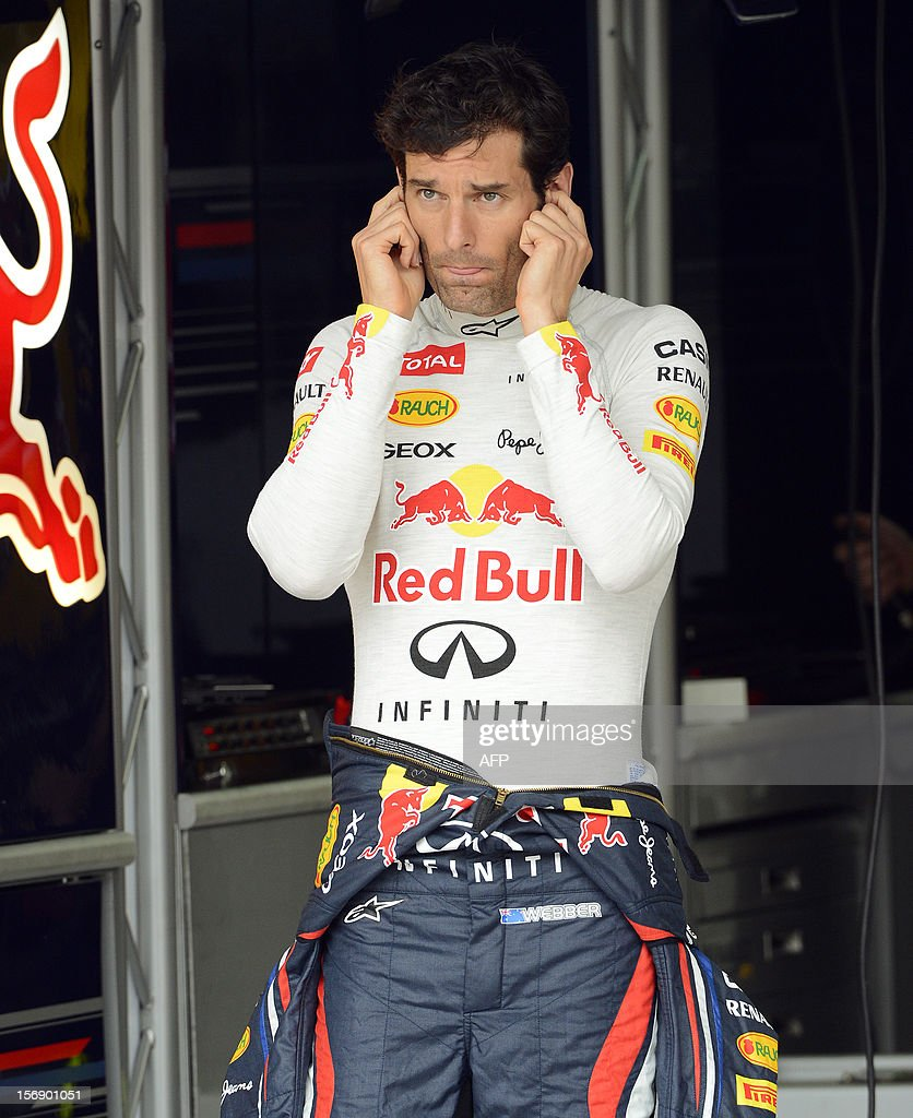 Australian Formula One driver Mark Webber cover his ears at the Red Bull pits during the qualifying session for the Brazilian GP on Sunday, at the Interlagos racetrack in Sao Paulo, Brazil on November 24 , 2012 .