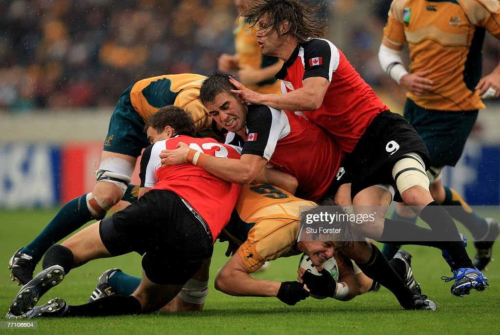 Australian forward Hugh Mcmeniman is stopped just short of the try line by the Canadian defence during the IRB Rugby World Cup Pool B match between...