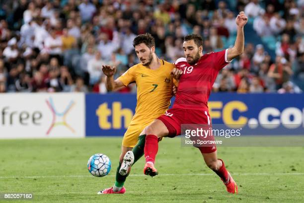 Australian forward Mathew Leckie and Syrian forward Mardik Mardikian fight for the ball at the Soccer World Cup Qualifier between Australia and Syria...