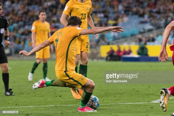 Australian forward Mathew Leckie takes a shot at goal at the Soccer World Cup Qualifier between Australia and Syria on October 10 2017