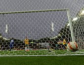 Australian goal keeper Mathew Ryan looks back to see the ball in the back of the net after Ali Hussain Fadhel of Kuwait heads a goal during the first...