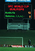 Australian goalkeeper Mark Bosnich stands under the scoreboard during Australia's 130 win over the Solomon Islands during the World Cup qualifying...