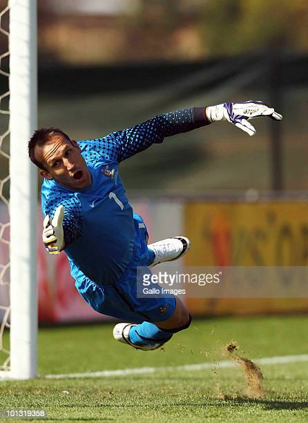 Australian goalkeeper Mark Schwarzer dives during the International Friendly between the Australian Socceroos and Denmark at Ruimsig Stadium on June...