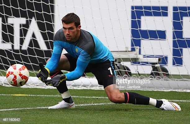 Australian goalkeeper Mathew Ryan of stops a shot during the Australian Socceroos training session at the Rectangular Stadium on January 8 2015 in...