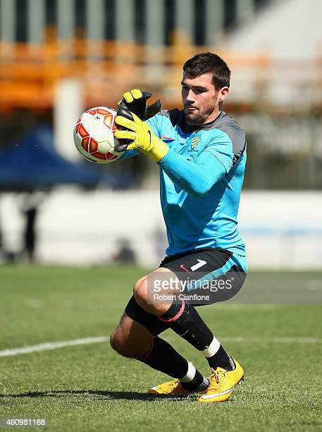 Australian goalkeeper Mathew Ryan stops a shot on goal during an Australian Socceroos training session at the Collingwood Training Ground on January...