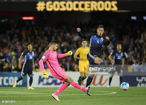 Australian goalkeeper Matt Ryan kicks the ball away from Keisuke Honda of Japanduring the 2018 FIFA World Cup Qualifier match between the Australian...