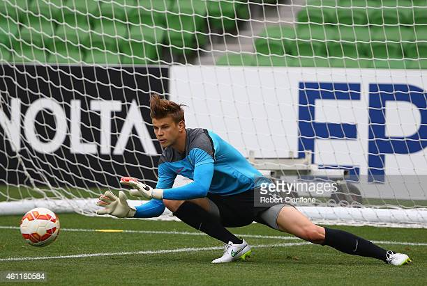 Australian goalkeeper Mitchell Langerak stops a shot during the Australian Socceroos training session at the Rectangular Stadium on January 8 2015 in...