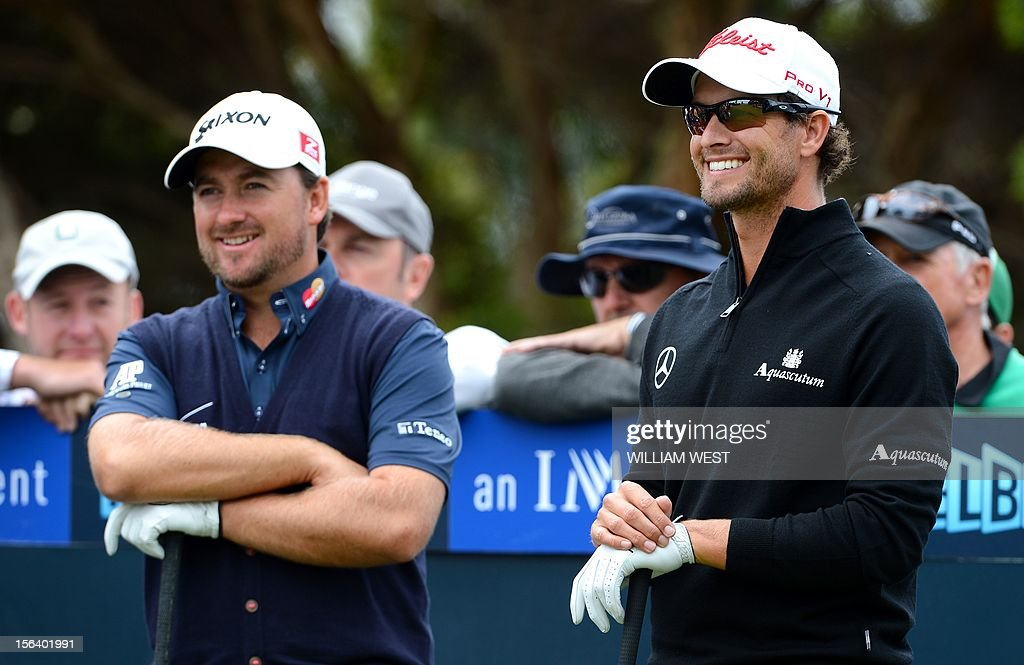 Australian golfer Adam Scott (R) shares a lighter moment with Graeme McDowell of Northern Ireland (L) during the first round of the Australian Master golf tournament being played at the Kingston Heath golf course in Melbourne on November 15, 2012. Scott is the early clubhouse leader at five under par. AFP PHOTO/William WEST IMAGE