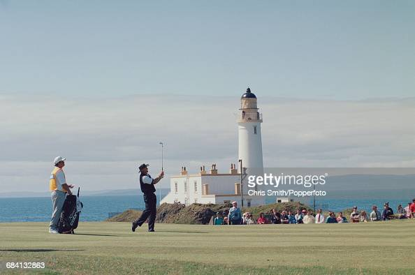 Australian golfer Greg Norman pictured in action during play with Turnberry Lighthouse in the background to finish in joint 11th place at the 1994...