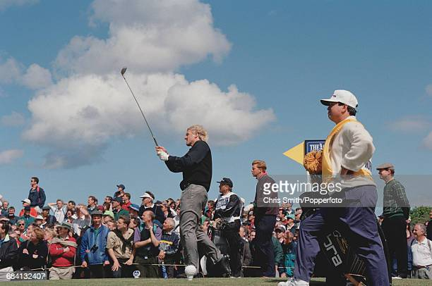 Australian golfer Greg Norman pictured teeing off during play to finish in joint 15th place at the 1995 Open Championship on the Old Course at St...