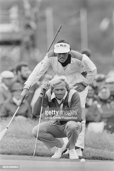 Australian golfer Greg Norman pictured with his caddy behind during action to win the 1986 Open Championship to become champion at Turnberry Golf...