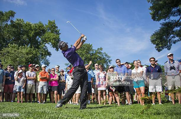 Australian golfer Jason Day hits from the rough during the first round of the Quicken Loans National at Congressional Country Club in Bethesda...