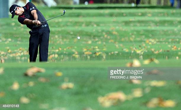 Australian golfer Jason Day plays a shot to the green at the fifth hole during the final round of the Northwestern Mutual World Challenge golf...