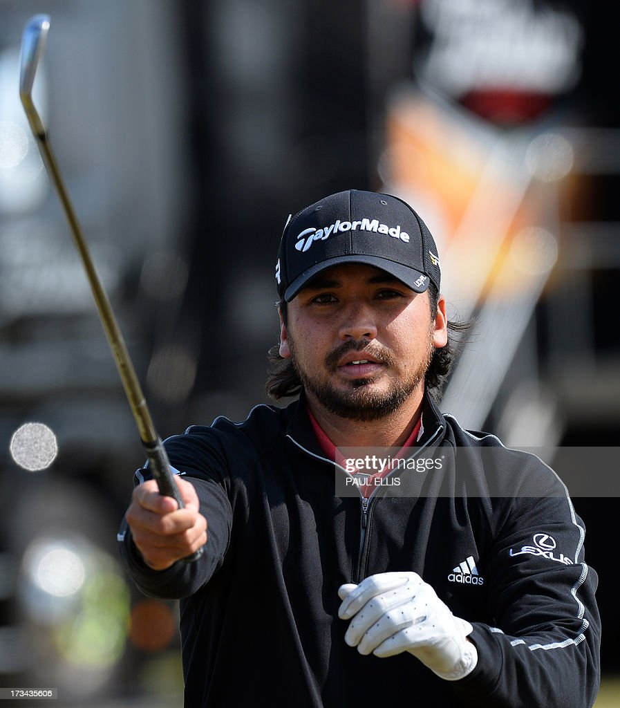Australian golfer <a gi-track='captionPersonalityLinkClicked' href=/galleries/search?phrase=Jason+Day+-+Golfeur&family=editorial&specificpeople=4534484 ng-click='$event.stopPropagation()'>Jason Day</a> stretches on the practice ground during practice for the 2013 British Open Golf Championship at Muirfield Golf Course in Gullane, eastern Scotland on July 14, 2013 ahead of the 142nd Open Championship which begins on July 18. It will be the 16th time the East Lothian course has held the championship, Ernie Els will defend the trophy he won at Royal Lytham last year, while Tiger Woods will look to win his 15th major title.