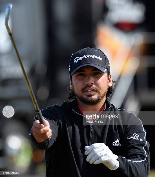 Australian golfer Jason Day stretches on the practice ground during practice for the 2013 British Open Golf Championship at Muirfield Golf Course in...