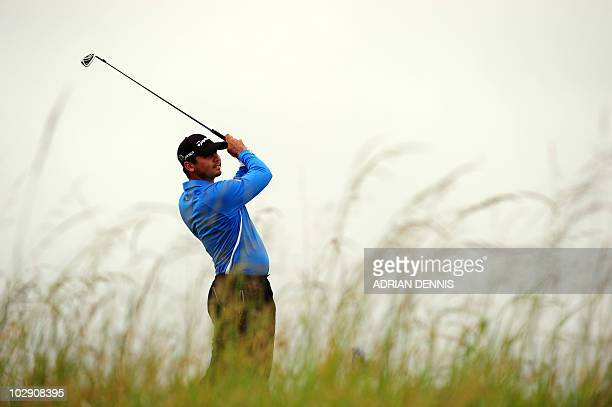 Australian golfer Jason Day watches his drive from the 6th tee during his opening Round on the first day of the British Open Golf Championship at St...