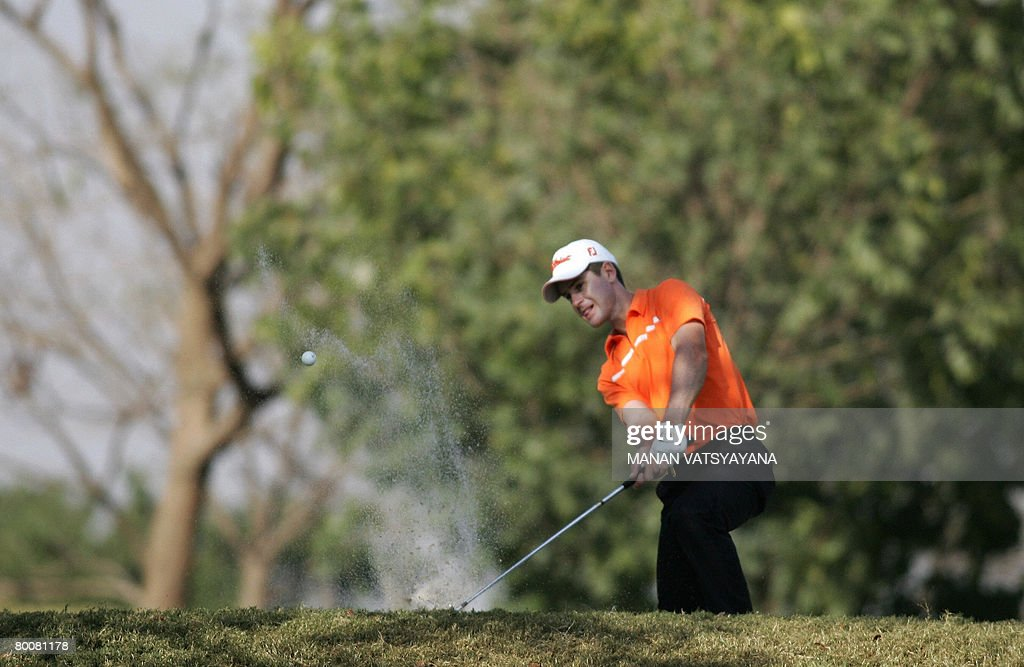 Australian golfer Scott Strange hits the ball out of the bunker on the eighteenth green during the final round of the Johnnie Walker Classic 2008 in...