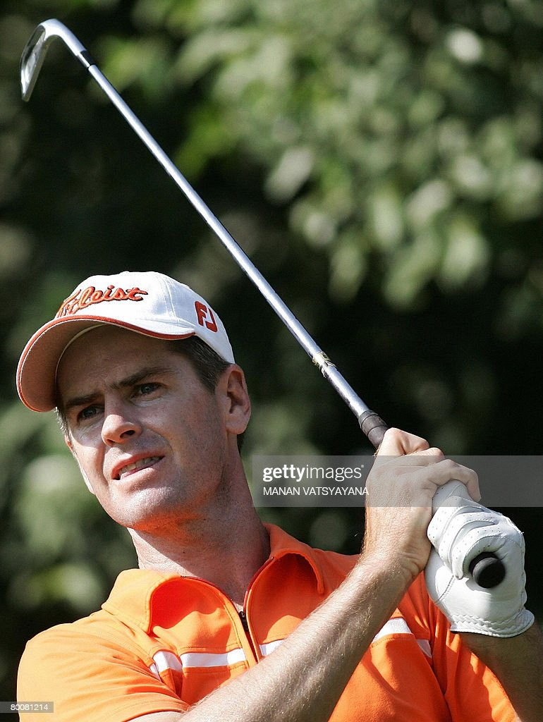 Australian golfer Scott Strange tees off during the final round of the Johnnie Walker Classic 2008 in Gurgaon on the outskirts of New Delhi on March...