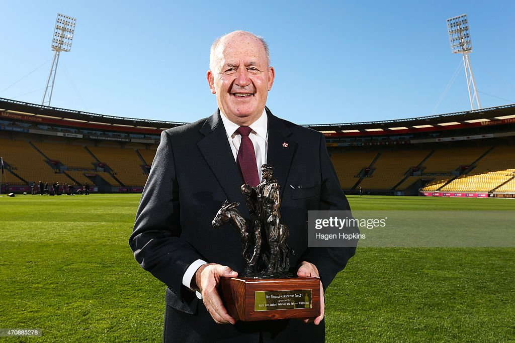 Australian Governor-General Sir Peter Cosgrove poses with The Simpson-Henderson Trophy after team training sessions at Westpac Stadium on April 24, 2015 in Wellington, New Zealand.