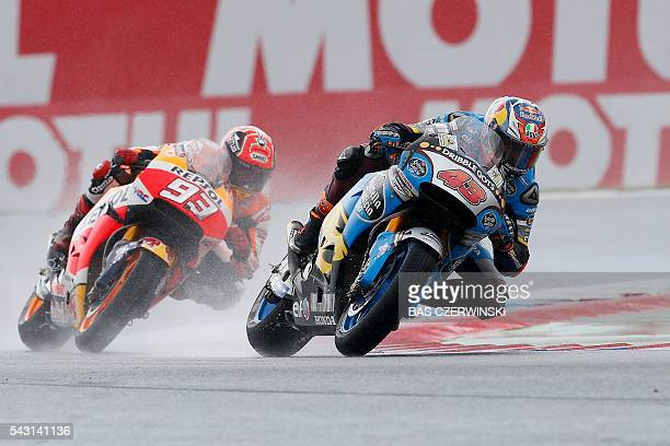 Australian GP rider Jack Miller of the Honda team and Spanish GP rider Marc Marquez of the Honda team compete during the GP race of the Motorcycling...