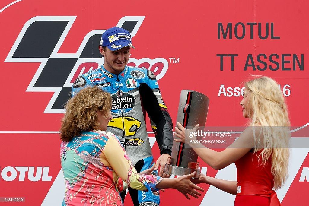 Australian GP rider Jack Miller of the Honda team receives his trophy after winning the GP race of the Dutch Motorcycling Grand Prix TT Assen at the TT Circuit on June 26, 2016 in Assen. / AFP / ANP / Bas Czerwinski / Netherlands OUT