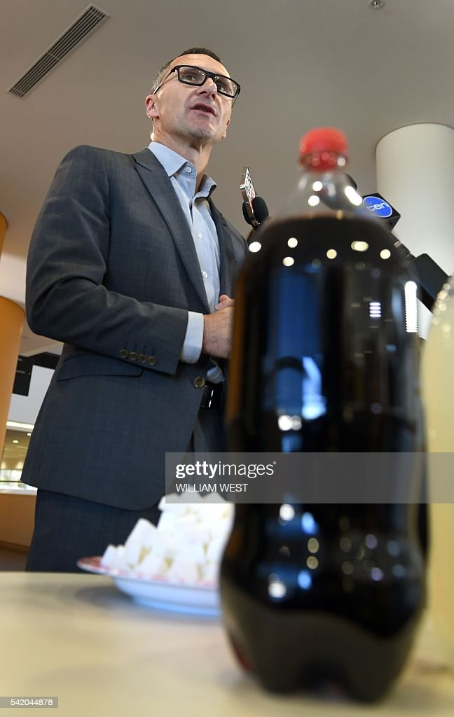 Australian Greens leader Richard Di Natale holds up a soft drink and a plate of sugar cubes as the party announces it will launch a tax on sugary...
