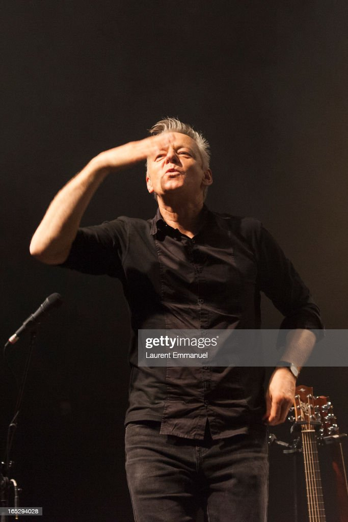 Australian guitarist Tommy Emmanuel acknowledges applause as he performs at La Cigale on April 2, 2013 in Paris, France.