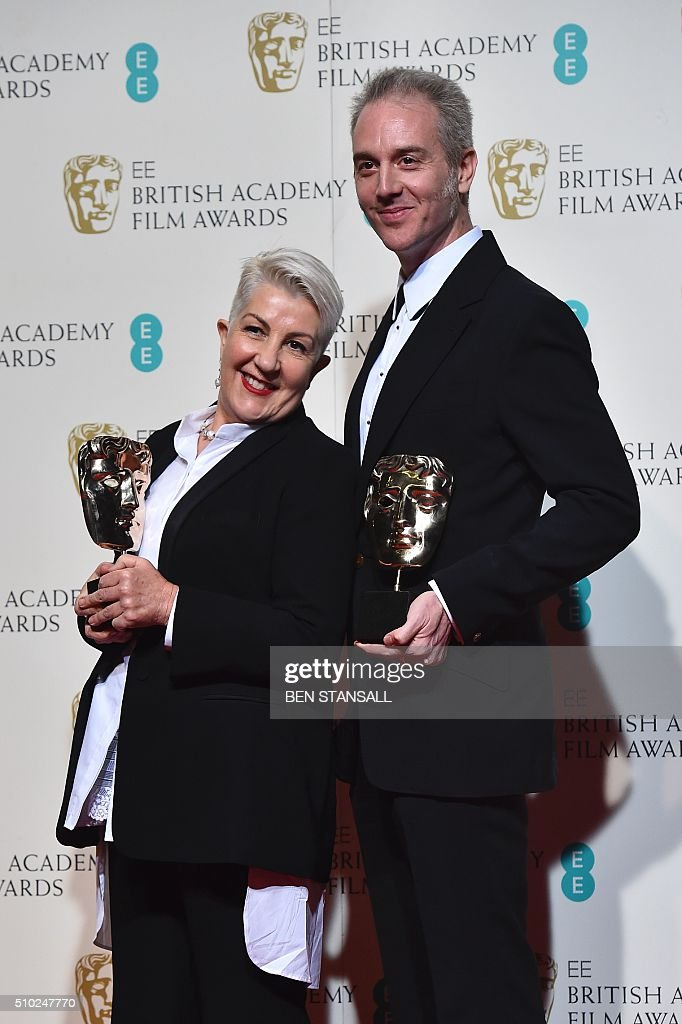 Australian hair designer and make-up artists Lesley Vanderwalt and Damian Martin pose with ther awards for make-up and hair for their work on the film 'Mad Max: Fury Road' at the BAFTA British Academy Film Awards at the Royal Opera House in London on February 14, 2016. AFP / BEN STANSALL / AFP / BEN STANSALL