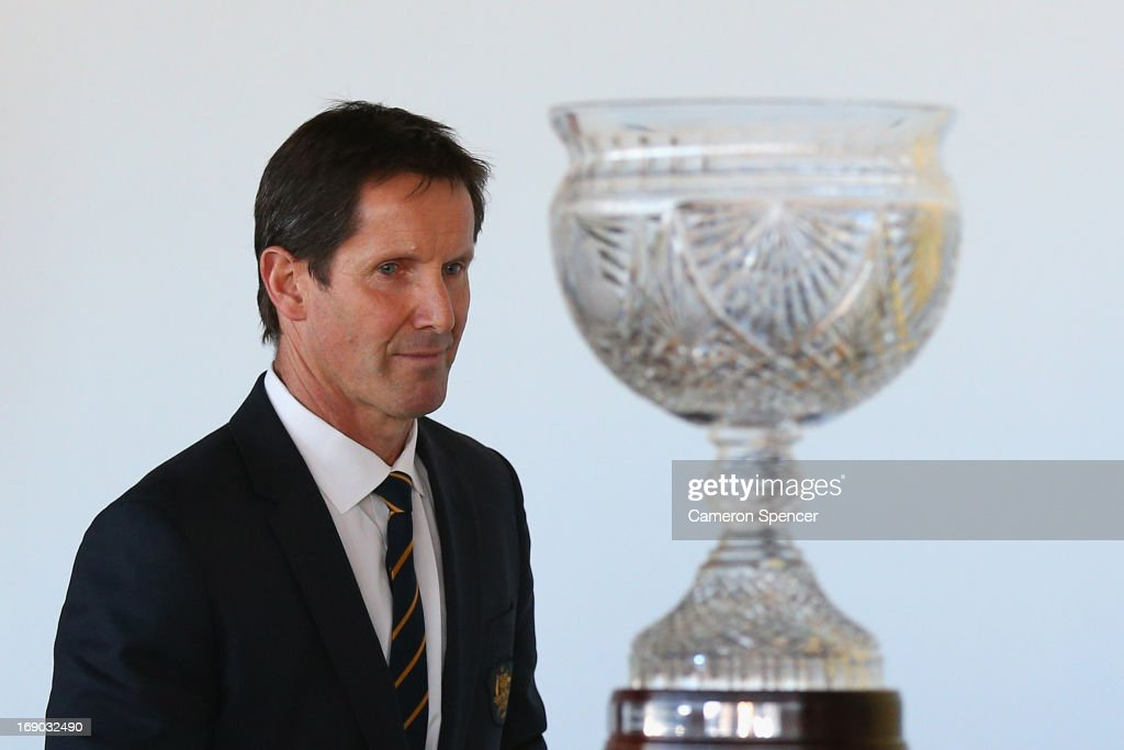 Australian head coach <a gi-track='captionPersonalityLinkClicked' href=/galleries/search?phrase=Robbie+Deans&family=editorial&specificpeople=606884 ng-click='$event.stopPropagation()'>Robbie Deans</a> walks past the Tom Richards Cup during an Australian Wallabies ARU press conference at Museum of Contemporary Art on May 19, 2013 in Sydney, Australia.