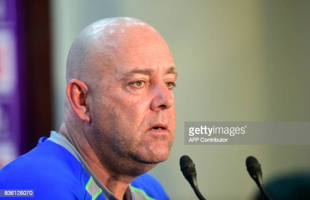Australian head cricket coach Darren Lehmann speaks during in a press conference at the ShereBangla National Cricket Stadium in Dhaka on August 21...