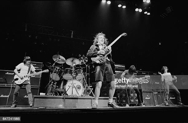 Australian heavy rock group AC/DC performing in New York August 1979 Left to right Malcolm Young Phil Rudd Angus Young Cliff Williams and Bon Scott