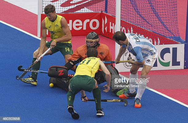 Australian hockey players Fergus Kavanagh Nick Budgeon and goalkeeper Tyler Lovell trying to stop an attack from Argentineanplayer Facundo Callioni...