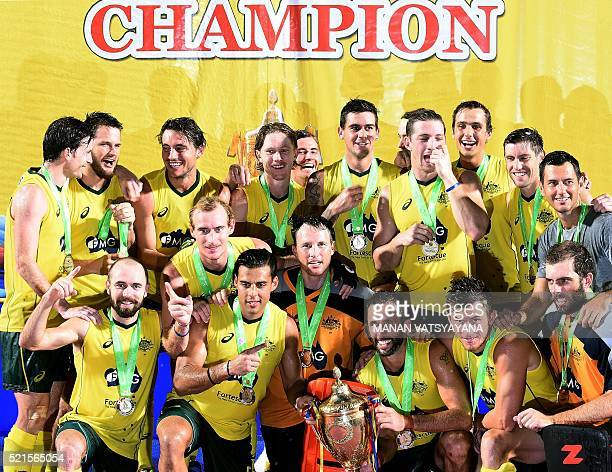 Australian hockey team players pose with the trophy after defeating India during the final match of the 2016 Sultan Azlan Shah men's field hockey...