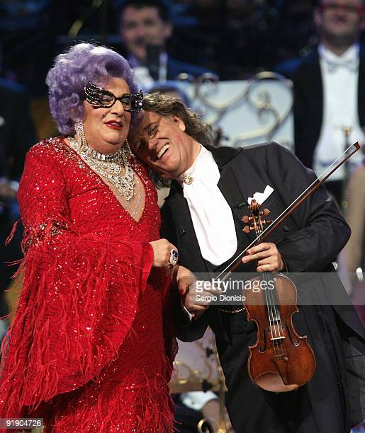 Australian icon Dame Edna Everage hugs musician Andre Rieu during his performance at Acer Arena on October 15 2009 in Sydney Australia