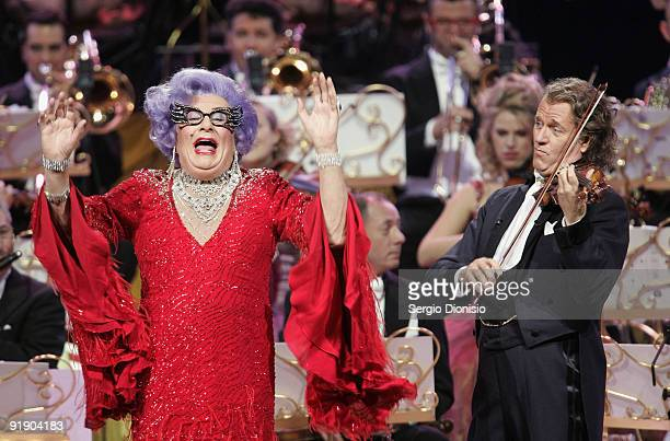Australian icon Dame Edna Everage performs alongside musician Andre Rieu on stage at Acer Arena on October 15 2009 in Sydney Australia